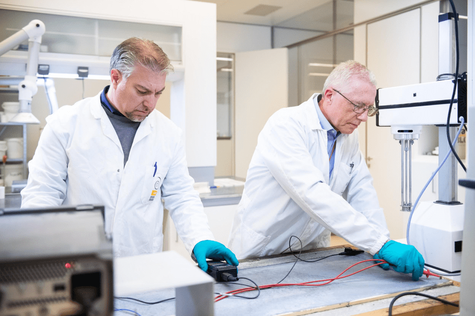 The researchers at the i-lab, the center for the research and innovation of Italcementi, are testing the properties of their new graphene-cementitious composite. (Courtesy of Italcementi press office)
