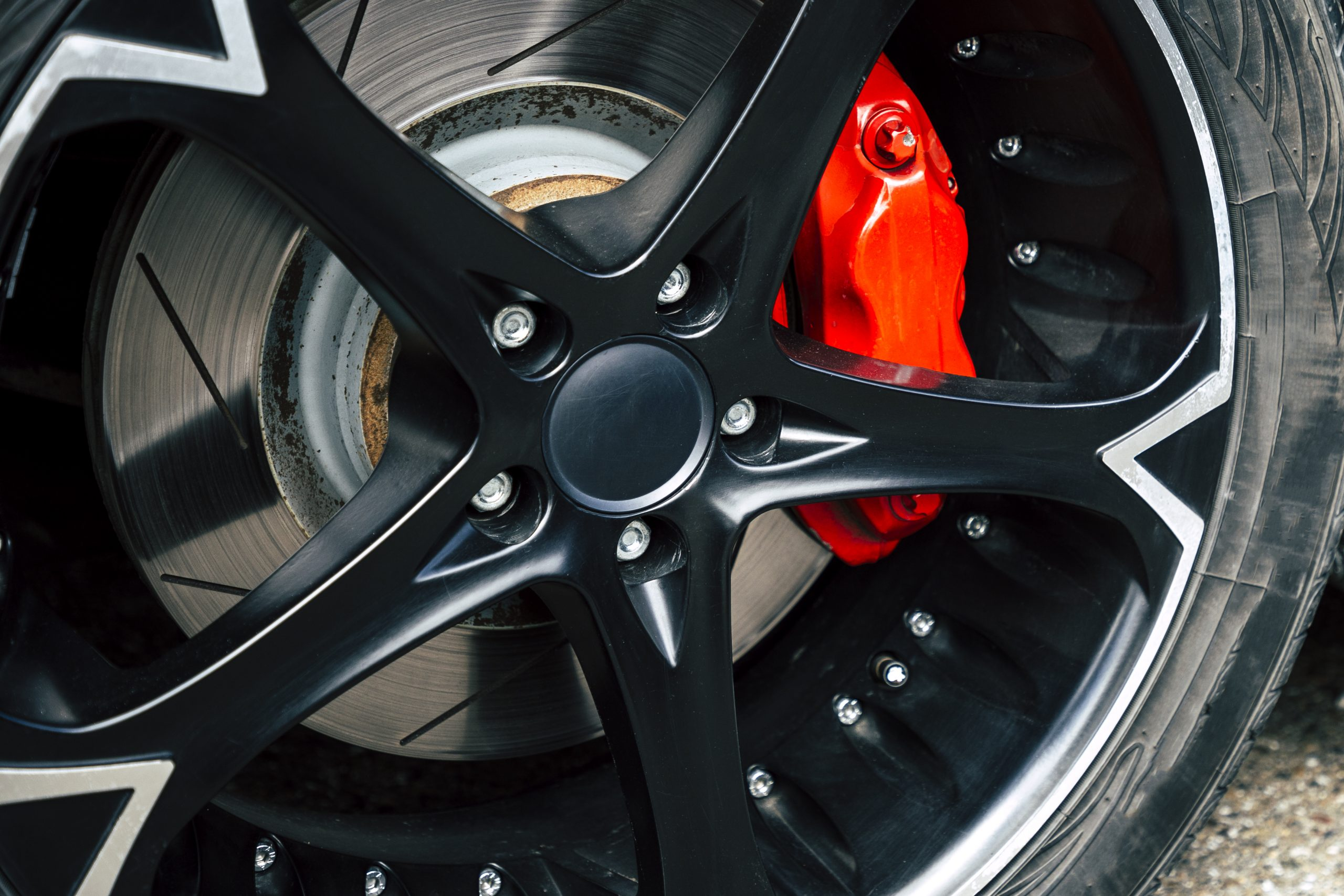 Red brake pads and discs of modern cars
